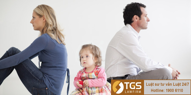 Upset couple sitting with baby girl